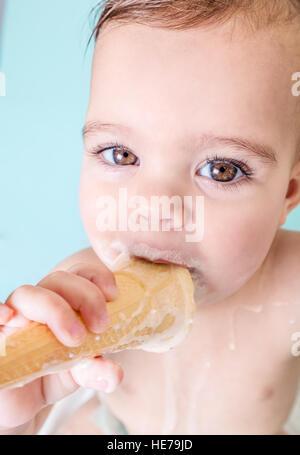 Portrait of Cute Toddler Girl Eating Melting Ice Cream - Stock Photo