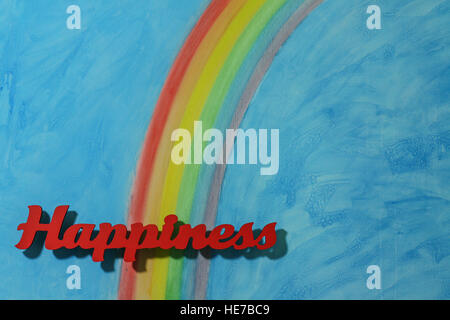 Red letters spelling the word happiness to illustrate the concept of joy, happy, love and wellness; landscape format. - Stock Photo