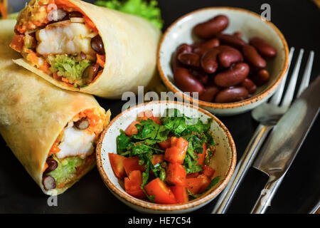 High Angle Still Life of Trio of Tex Mex Fajita Wraps Wrapped in Grilled Flour Tortillas and Filled with Variety - Stock Photo