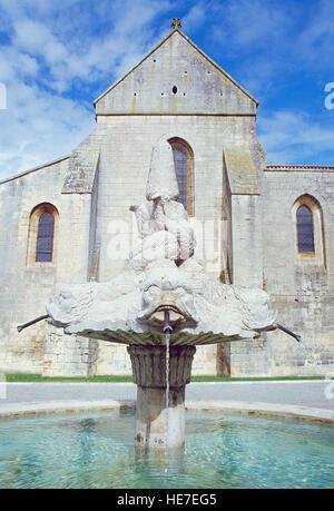Fountain and church. Las Huelgas monastery, Burgos, Spain. - Stock Photo
