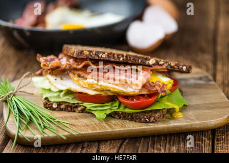 Fresh made Bacon and Egg Sandwich (selective focus; close-up shot) - Stock Photo
