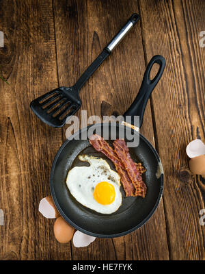 Portion of Bacon and Eggs (selective focus; close-up shot) - Stock Photo