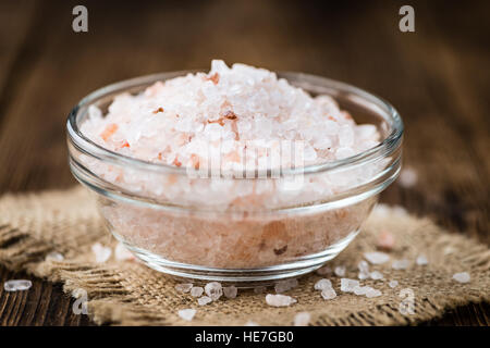 Himalayan Salt as high detailed close-up shot on a vintage wooden table (selective focus) - Stock Photo