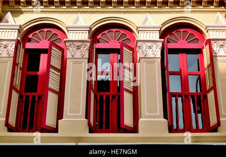 Singapore traditional shop house with red shutters in Temple Street, Chinatown - Stock Photo