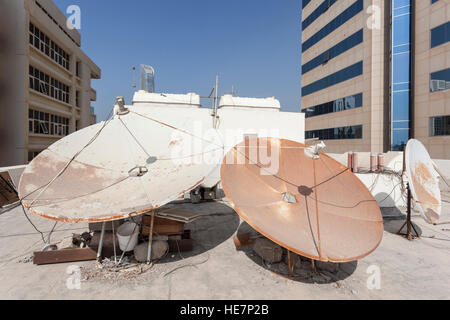 Satellite dish on the house roof - Stock Photo