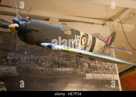 model of a spitfire hanging in a austion sale room. - Stock Photo
