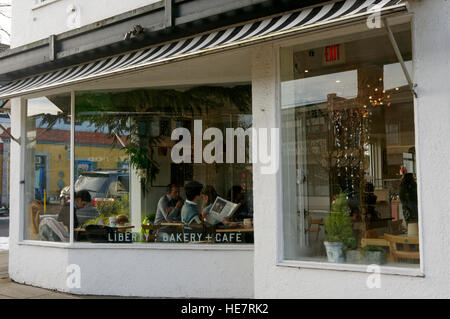 People sitting in the Liberty Bakery and Cafe on Main Street, Vancouver, British Columbia, Canada - Stock Photo