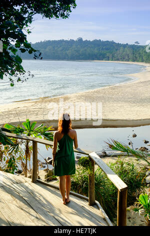 A young woman looks out over a deserted beach, Kaktus resort, Koh Ta Kiev, Sihanoukville, Cambodia - Stock Photo