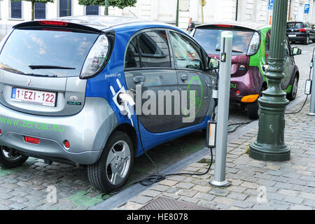 An electric hybrid car being charged on the street in Brussels, Belgium. - Stock Photo