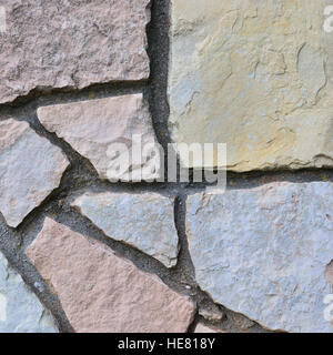 Stone fence background, vertical stonewall closeup, decorative limestone dolomite calcium carbonate hard sedimentary - Stock Photo