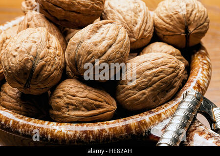 Close up of unshelled walnuts. - Stock Photo