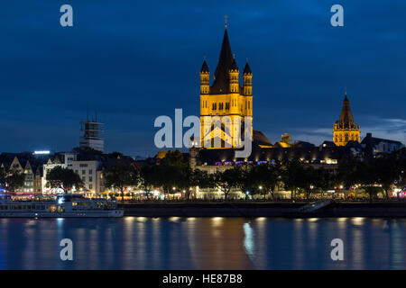 Night view of the River Rhine and the Great Saint Martin Church in Cologne, Germany. - Stock Photo