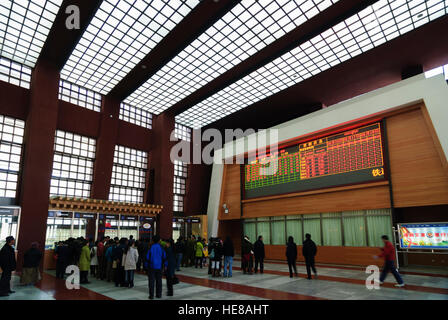 Lhasa: Railway station; Pending at the ticket counter, Tibet, China - Stock Photo