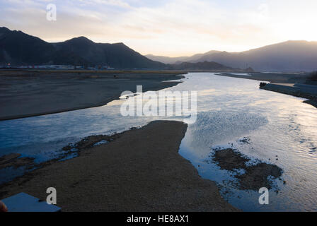 Lhasa: River Kyichu overlooking the railway station at sunset, Tibet, China - Stock Photo