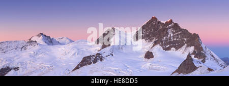 Dawn and first light over the Jungfrau peak from Jungfraujoch in Switzerland on a clear morning. - Stock Photo