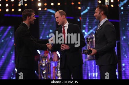 Michael Phelps receives the Lifetime Achievement Award from the Duke of Cambridge and Ian Thorpe during the BBC - Stock Photo