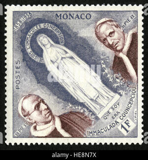 MONACO - Postage stamp from Monaco depicting the Virgin Mary, Popes Pius IX and XII, centenary of appearance of - Stock Photo