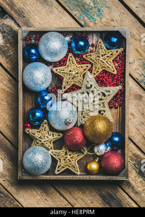 Christmas tree toy stars, balls and garland in wooden box - Stock Photo