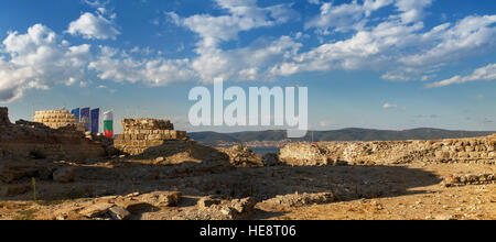 Ruins and the remains of an ancient fortress wall in the old town of Nessebar, on the Black Sea coast. - Stock Photo