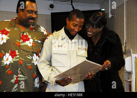 David Huff, cadet with the Alaska Military Youth Academy, smiles with his parents, Darryl and Bridgett, after receiving - Stock Photo