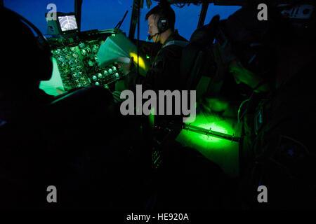 U.S. Air Force Capt. Daniel Shure, a C-130H Hercules aircraft pilot, and Master Sgt. Shawn Plunkett, a flight engineer, - Stock Photo