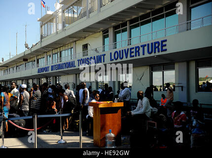 U.S. citizens living in Haiti wait to be evacuated from the Troussaint Louverture International Airport in Port - Stock Photo