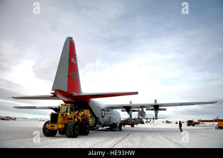 An LC-130 Hercules is unloaded Nov. 27 on the ice runway near McMurdo Station, Antarctica, during Operation Deep - Stock Photo