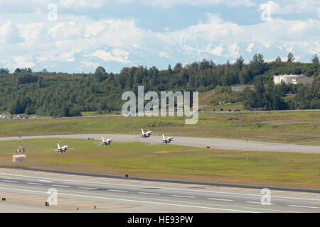 Members of the Air Force Thunderbirds Aerial Demonstration Team perform at Joint Base Elmendorf-Richardson's Arctic - Stock Photo