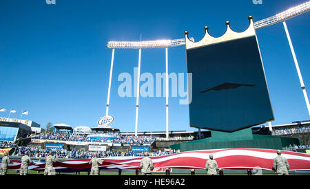 Airmen hold the American flag during the Royals vs. Orioles baseball game at Kaufmann Stadium in Kansas City, Mo., - Stock Photo