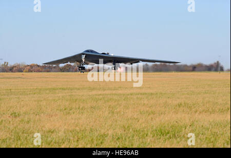 A B-2 Spirit launches from the runway during an exercise at Whiteman Air Force Base, Mo., Nov. 8, 2015. The B-2 - Stock Photo
