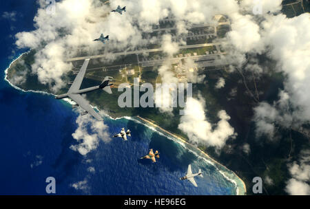 A B-52 Stratofortress from the 23rd Expeditionary Bomb Squadron leads a formation of Japanese Air Self Defense Force - Stock Photo