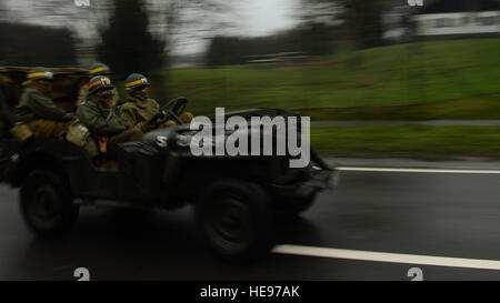 Reenactors drive a World War II-era jeep during the 36th Bastogne Historic Walk Dec. 14, 2013. Spectators viewed - Stock Photo