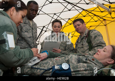 U.S. Air Force Major Lisa Seltman, 140th Medical Group, simulates a patient as fellow 140th MDG personnel 2nd Lt. - Stock Photo