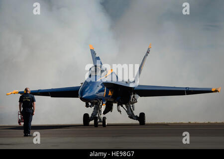 A U.S. Navy Flight Demonstration Squadron Blue Angels crew chief prepares to marshal an F/A-18 Hornet during the - Stock Photo