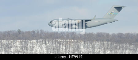 A C-17A Globemaster III from Dover Air Force Base, Del., practices low-level terrain masking techniques over the - Stock Photo
