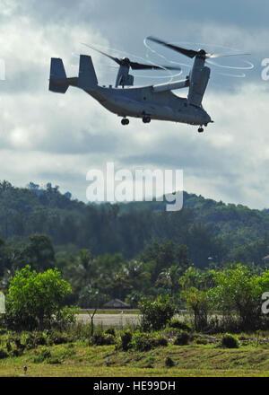RIMBA AIR BASE, Brunei -- A U.S. Marine Corps MV-22B Osprey prepares to land after a flight at Rimba Air Base during - Stock Photo