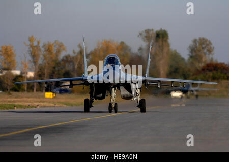 MiG-29s from Graf Ignattevo Airfield, Bulgaria taxis toward the end of runway for take off Oct. 17, 2007.  Over - Stock Photo