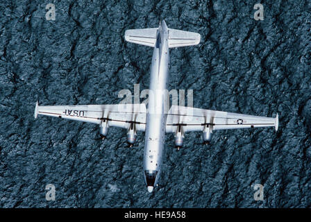 An air-to-air overhead view of a restored C-124 Globemaster II aircraft over San Francisco Bay.  The aircraft is - Stock Photo