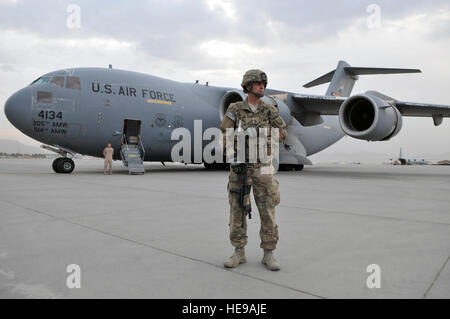 Army Sergeant 1st Class Jon Waterhouse, deployed from the 127th Military Police Company, Fort Carson, Colo., provides - Stock Photo