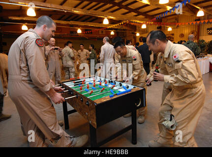 U.S. service members Combined Joint Task Force- Horn of Africa, at Camp Lemonier, Djibouti, share a game of foosball - Stock Photo