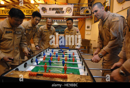 U.S. service members with Combined Joint Task Force- Horn of Africa, aboard Camp Lemonier, Djibouti, share a game - Stock Photo
