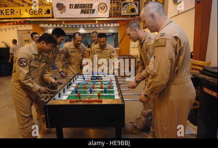 U.S. service-members with Combined Joint Task Force- Horn of Africa at Camp Lemonier, Djibouti, share a game of - Stock Photo