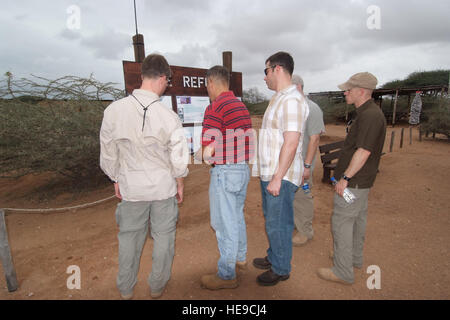 US Air Force Lt Col Greg Petrequin (second from left) explains information about the Cheetah Refuge in Djibouti - Stock Photo