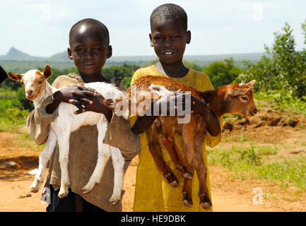 Two local village boys bring their baby goats to be vaccinated during a veterinary civic action project June 5, - Stock Photo