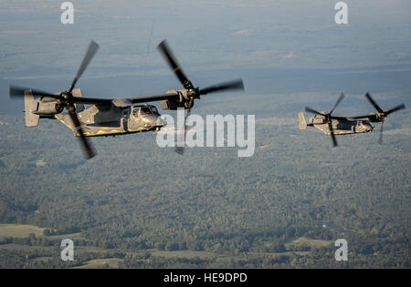 Two CV-22 Ospreys approach an MC-130H Combat Talon II air-refueling receptacle during a training mission at Hurlburt - Stock Photo