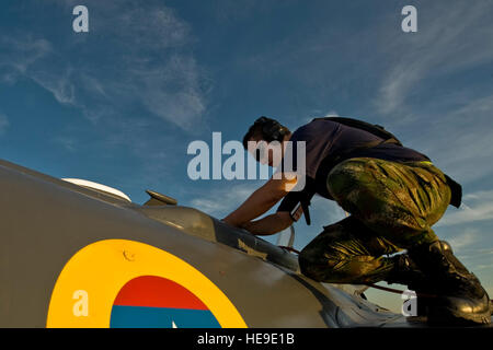 Colombian air force crew chief Suarez Miller prepares to drain a fuel tank on a Kfir during Red Flag 12-4 July 23, - Stock Photo