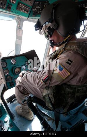 U.S. Air Force Capt. Adam Ackerman, MI-17 pilot adviser, 441st Air Expeditionary Advisory Squadron, flies a MI-17 - Stock Photo
