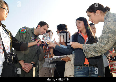 BANGKOK, Thailand  - Capt. Genevieve David (right), a Public Affairs Officer with 13th Air Force leans in to capture - Stock Photo