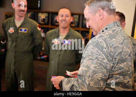 Chief of Staff of the Air Force Gen. Mark A. Welsh III, right, looks at coins and patches presented from the 432nd - Stock Photo
