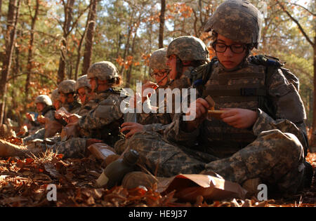 Soldiers in training prepare for dinner after performing a live-fire exercise during U.S. Army basic training at - Stock Photo